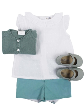 Girl look. Green short with white blouse
